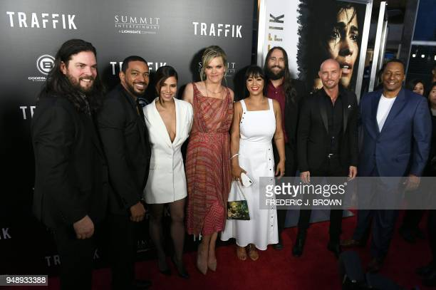 Members of the cast gather for a group photo at the premiere of the film 'Traffik' in Hollywood California on April 19 2018