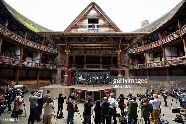 Members of the cast of a new touring production of William Shakespeare's 'Hamlet' perform during a photocall at the Globe theatre in London on April...