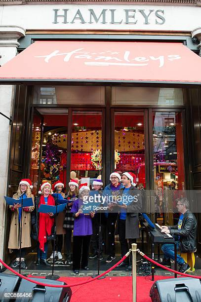 Members of the cast of Charlie and the Chocolate Factory sing festive songs before Hamleys unveil their Christmas window display at their Oxford...