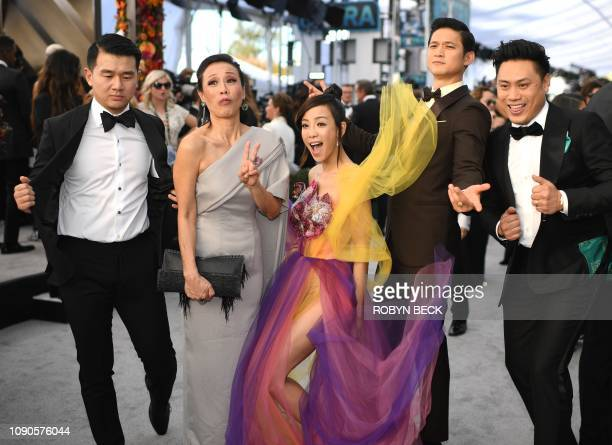 Members of the cast of 'Crazy Rich Asians' Ronny Chieng Tan Kheng Hua Fiona Xie Harry Shum Jr and director Jon M Chu walk the red carpet at the 25th...