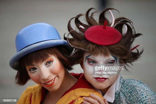 Members of the cast of Quidam from Cirque de Soleil perform outside the Royal Albert Hall on September 17 2013 in London England Quidam a story of a...