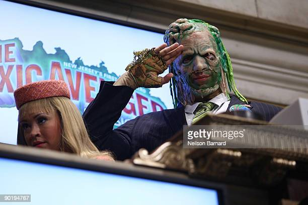 Members of the cast of The Toxic Avenger Diana DeGarmo and Nick Cordero ring the opening bell at the New York Stock Exchange on August 31 2009 in New...