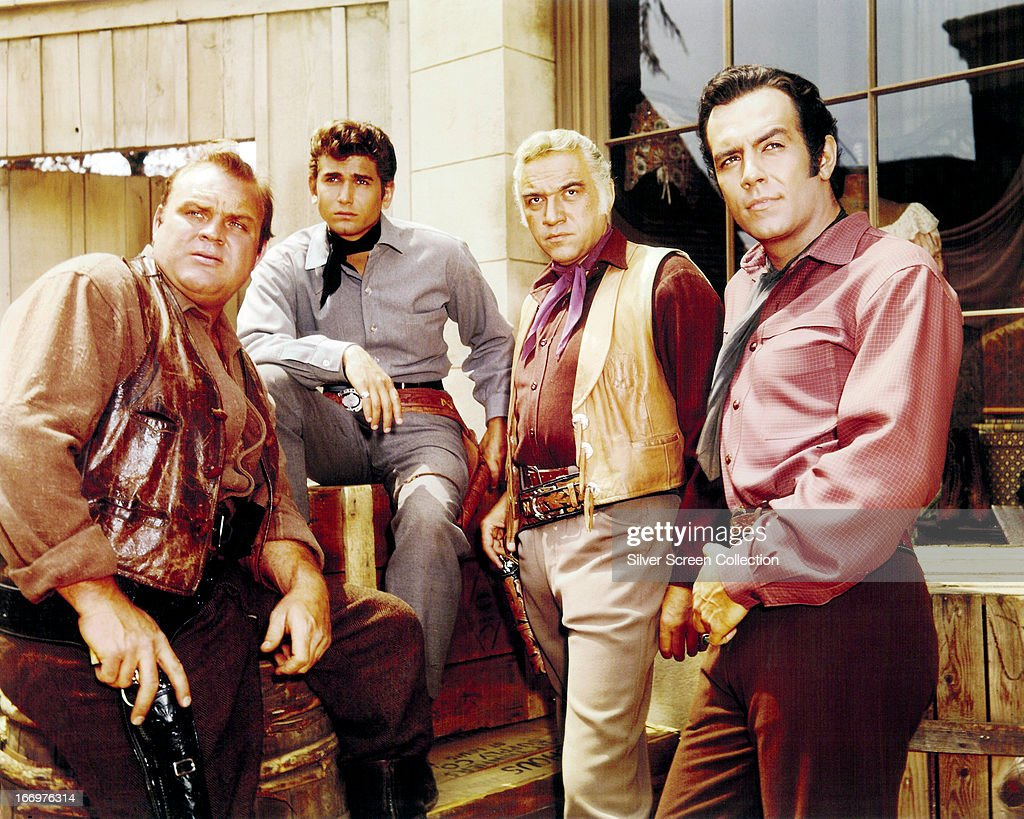Members of the cast of the TV western series 'Bonanza', circa 1965. Left to right: Dan Blocker (1928 - 1972) as Eric 'Hoss' Cartwright, Michael Landon (1936 - 1991) as Joseph 'Little Joe' Cartwright, Lorne Greene (1915 - 1987) as Ben Cartwright and Pernell Roberts (1928 - 2010) as Adam Cartwright.