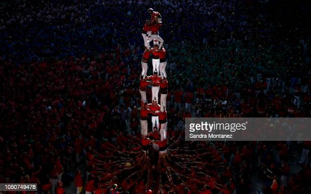 Members of the Castellers de Barcelona build a human tower during the 27th Tarragona Competition on October 07 2018 in Tarragona Spain The...