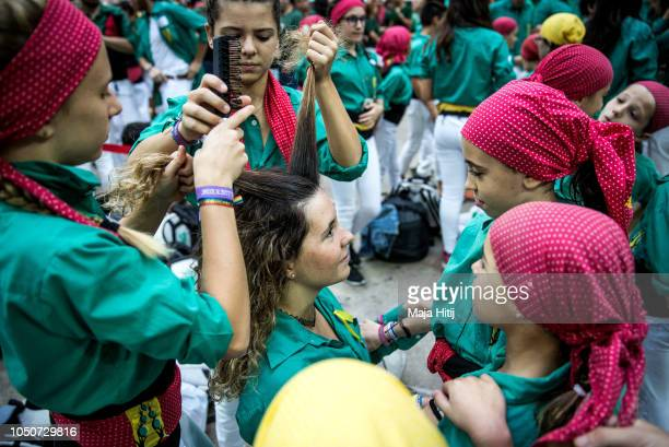 Members of the Castellers de Sabadell prepare to build a human tower during the 27th Tarragona Competition on October 07 2018 in Tarragona Spain The...