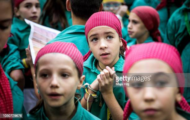 Members of the Castellers de Sabadell react as they built a human tower during the 27th Tarragona Competition on October 07 2018 in Tarragona Spain...