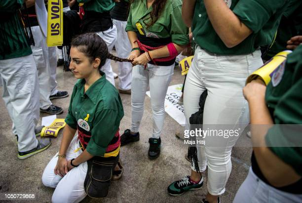 Members of the Castellers de Sant Cugat prepare to build a human tower during the 27th Tarragona Competition on October 07 2018 in Tarragona Spain...