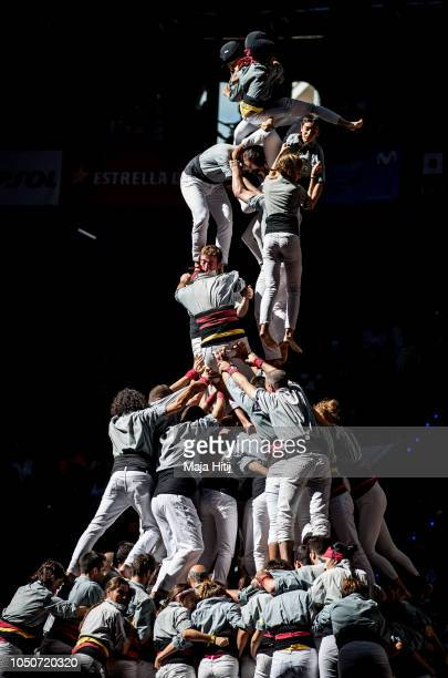 Members of the Castellers de Sants fall down as they built a human tower during the 27th Tarragona Competition on October 07 2018 in Tarragona Spain...