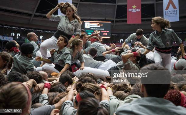 Members of the Castellers de Sants react after falling and building a human tower during the 27th Tarragona Competition on October 07 2018 in...