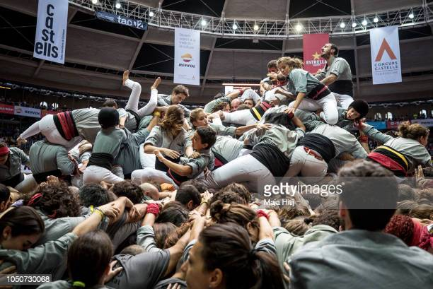 Members of the Castellers de Sants react after falling as they built a human tower during the 27th Tarragona Competition on October 07 2018 in...