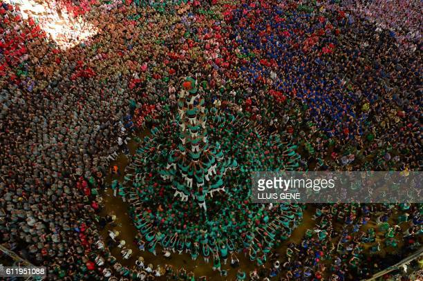 Members of the Castellers de Vilafranca human tower team form a castell during the XXVI human towers or 'castells' competetion in Tarragona on...