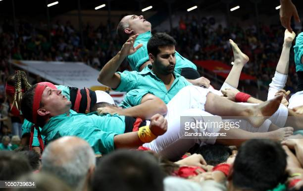 Members of the Castellers de Vilafranca react as they built a human tower during the 27th Tarragona Competition on October 07 2018 in Tarragona Spain...