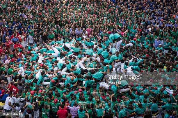 Members of the Castellers de Vilafrance collapse in their attempt to built a human tower during the 27th Tarragona Competition on October 07 2018 in...