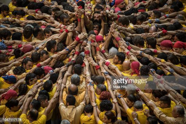 Members of the Castellers de Villnova built a human tower during the 27th Tarragona Competition on October 06 2018 in Tarragona Spain The...