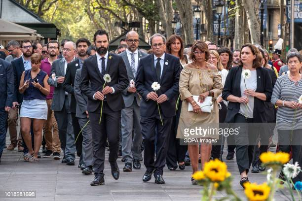 Members of the Catalan government and the municipality are seen with flowers at the Ramblas Barcelona celebrated the first anniversary of the...