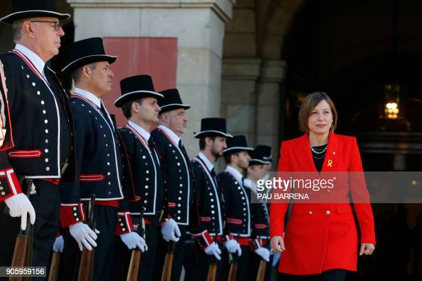 Members of the Catalan regional police force Mossos d'Esquadra salute former president of Catalan parliament Carme Forcadell before Catalan's...