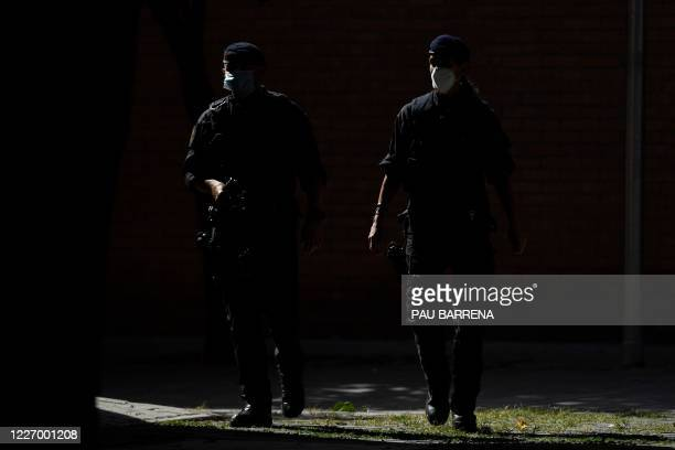 Members of the Catalan regional police force Mossos d'Esquadra stand guard during an counter-terrorism operation in Barcelona, on July 14, 2020.