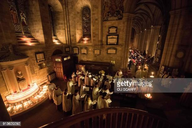 Members of the cathedral choir prepare to take part in a candlelit procession as they attend the Candlemas Festal Eucharist service at Ripon...