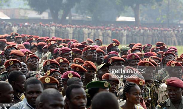 Members of the Central African Armed Forces listen to interim president Catherine Samba Panza's speech on February 5 in Bangui during a military...
