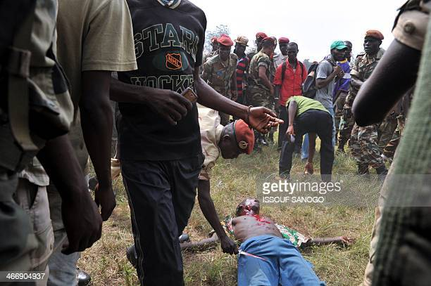 Members of the Central African Armed Forces lynch a man suspected of being a former Seleka rebel on February 5 in Bangui The impoverished former...