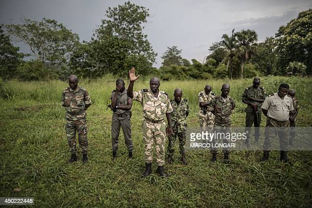 Members of the Central African Armed Forces pray during a muster at their base at Camp Kasai in Bangui on June 7 2014 Sectarian violence between...
