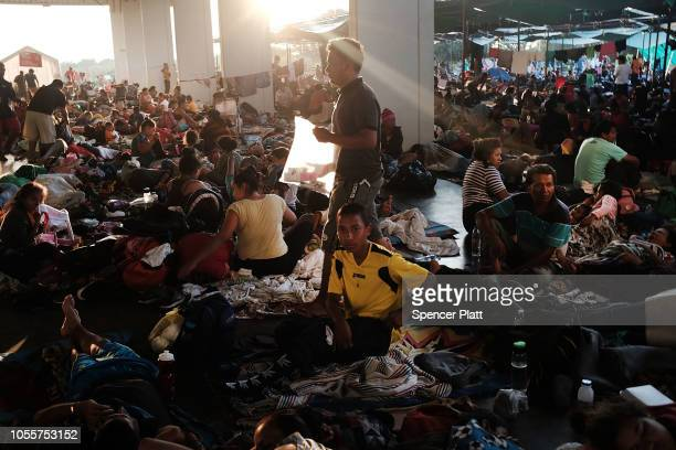Members of the Central American caravan wake up after spending the night in a camp on October 31 2018 in Juchitan de Zaragoza Mexico The group of...
