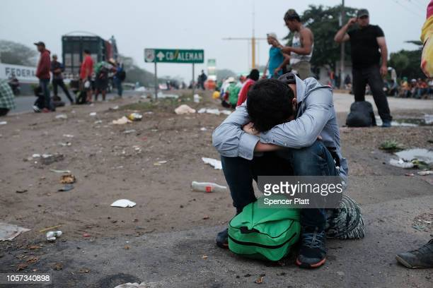 Members of the Central American migrant caravan move in the early hours towards their next destination on November 04, 2018 in Isla, Mexico. The...