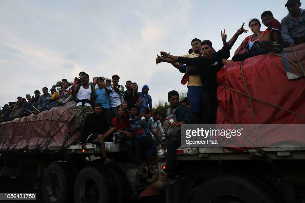 Members of the Central American migrant caravan move to the next town at dawn on November 02 2018 in Matias Romero Mexico The group of migrants many...