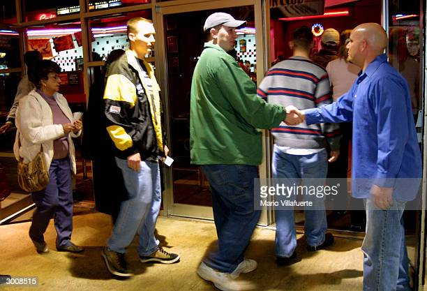 Members of the Central Assembly of God Church line up to enter the Regal Cinema movie theater for a prescreening of The Passion of the Christ...
