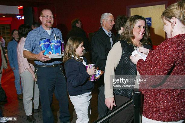 Members of the Central Assembly of God Church line up to enter the Regal Cinema movie theater for a prescreening of 'The Passion of the Christ'...
