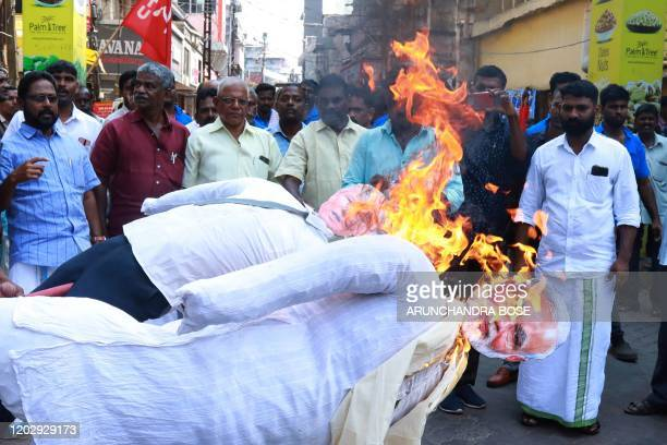 Members of the Centre of Indian Trade Unions CITU a proCommunist Party of India trade union burn effigys of US President Donald Trump and Indian...