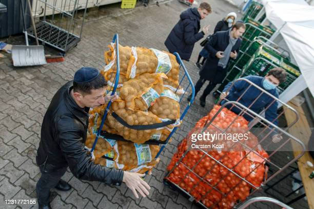 Members of the Chabad Berlin Jewish community prepare packages for their needy co-members ahead of the Jewish holiday of Passover on March 17, 2021...