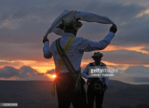 Members of the Chapel-en-le-Frith Morris dancers celebrate May Day with a socially-distanced dance on the top of Eccles Pike, an isolated hill in the...