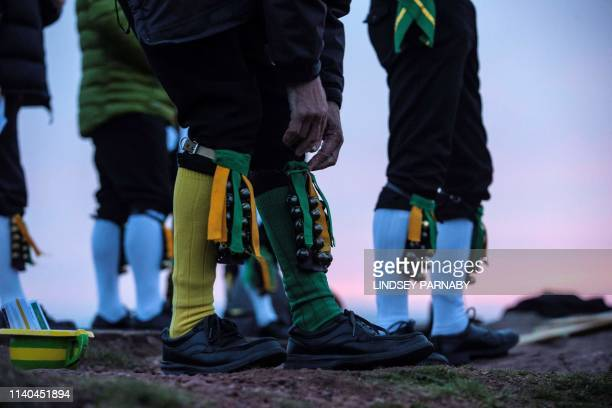 Members of the ChapelenleFrith Morris Dancers dance atop the Eccles Pike at High Peak in Derbyshire before sunrise on May 1 2018 The ChapelenleFrith...
