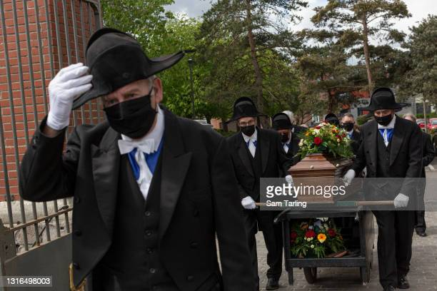 Members of the Charitable Brotherhood of Saint-Eloi in Béthune carry the coffin of Jacques Dufour, an 86-year-old man who died of COVID-19 after...