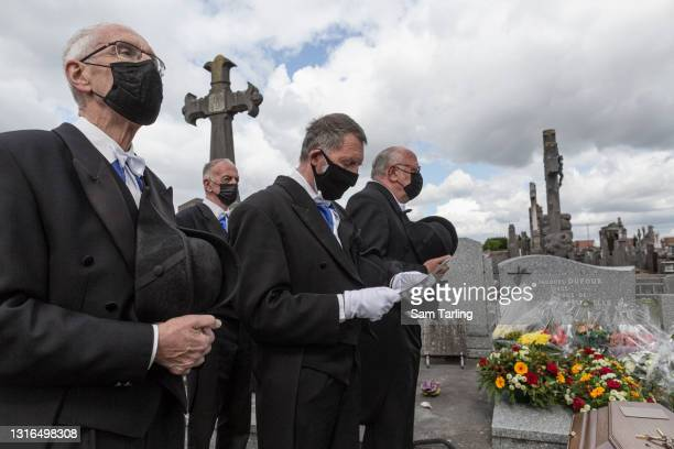 Members of the Charitable Brotherhood of Saint-Eloi in Béthune officiate the burial of Jacques Dufour, an 86-year-old man who died of COVID-19 after...
