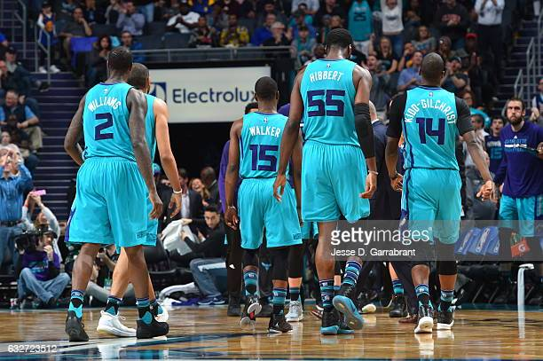 Members of the Charlotte Hornets look on against the Golden State Warriors at Spectrum Center on January 25 2017 in Charlotte North Carolina NOTE TO...
