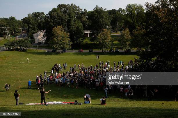 Members of the Charlottesville community gather at Washington Park for an event marking the one year anniversary of a deadly clash between white...