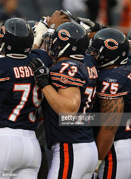 Members of the Chicago Bear defense including Nick Osborn Dan Bazuin and Matt Toeaina prepare to play against the San Francisco 49ers on August 21...