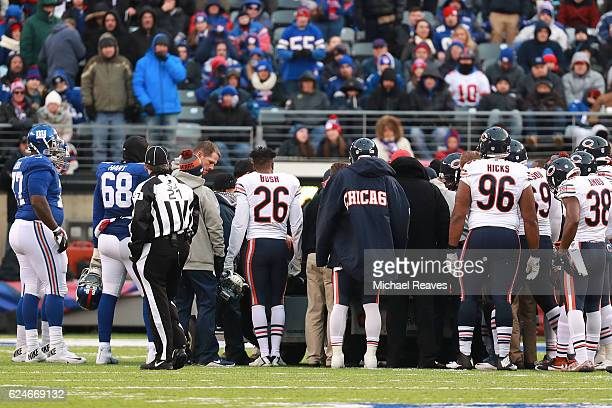 Members of the Chicago Bears and the New York Giants show support for Leonard Floyd of the Chicago Bears after he was injured during the second half...