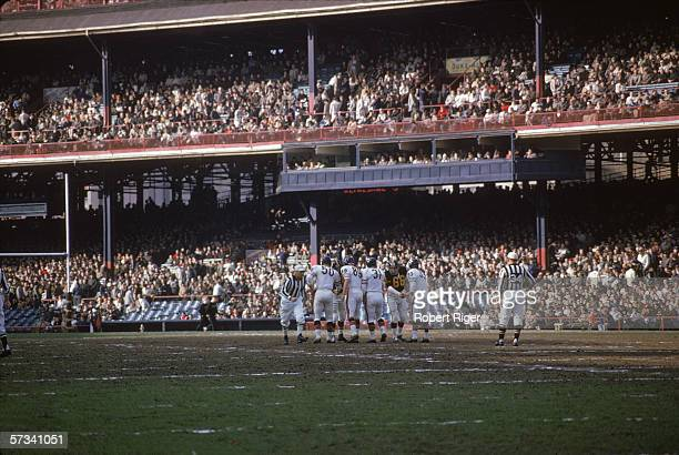 Members of the Chicago Bears and the Pittsburgh Steelers football teams shake hands on the field before the start of a game at Forbes Field...