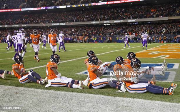 Members of the Chicago Bears offense led by Anthony Miller celebrate Millers' touchdown catch against the Minnesota Vikings at Soldier Field on...