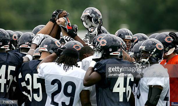 Members of the Chicago Bears prepare for the first summer training camp practice on July 27, 2006 at Olivet Nazarene University in Bourbonnais,...