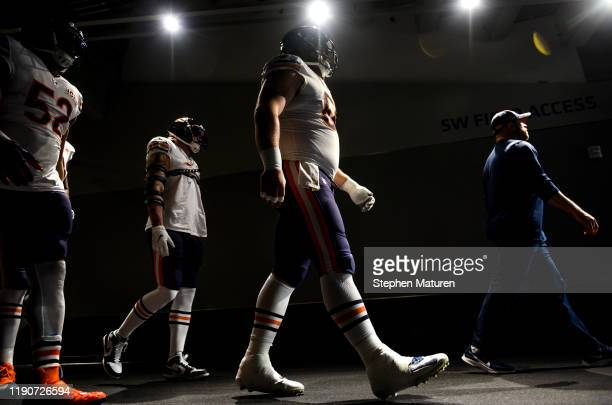 Members of the Chicago Bears walk out of the tunnel during pregame warmups before playing the Minnesota Vikings at US Bank Stadium on December 29...