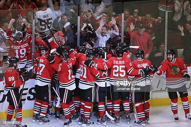 Members of the Chicago Blackhawks celebrate a win against the Detroit Red Wings in Game Seven of the Western Conference Semifinals during the 2013...