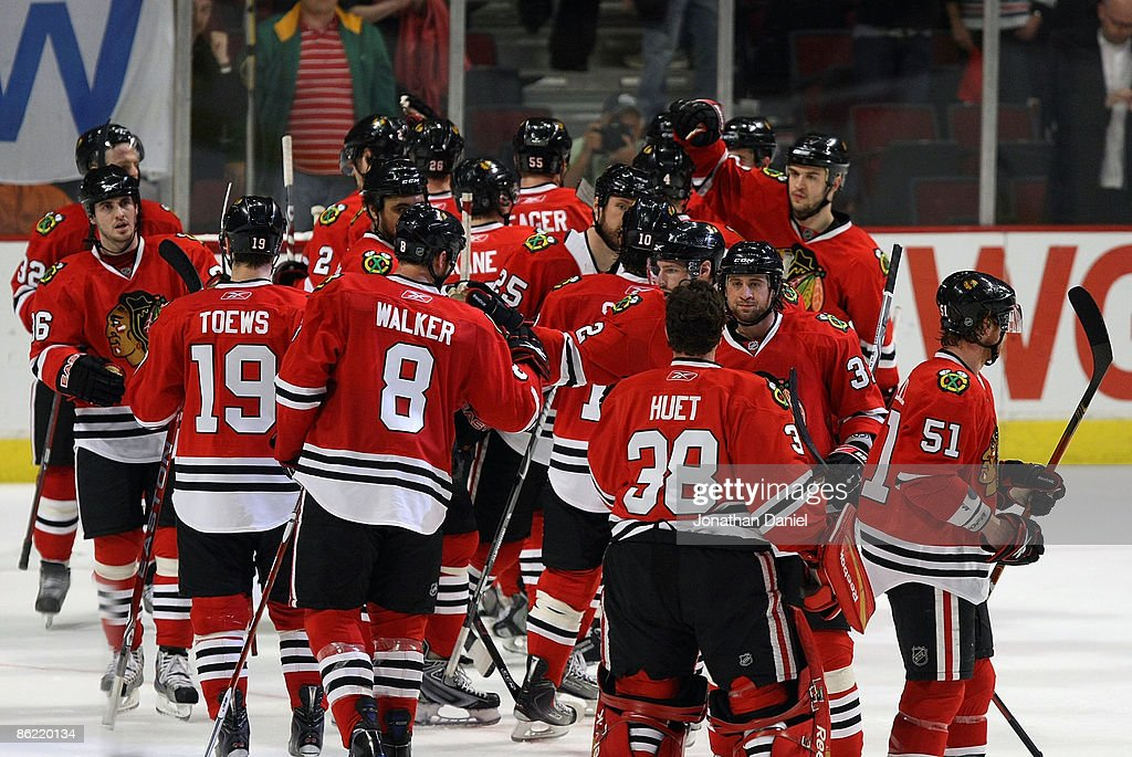 Members of the Chicago Blackhawks celebrate a win over the Calgary Flames during Game Five of the Western Conference Quarterfinals of the 2009 Stanley Cup Playoffs on April 25, 2009 at the United Center in Chicago, Illinois. The Blackhawks defeated the Flames 5-1.