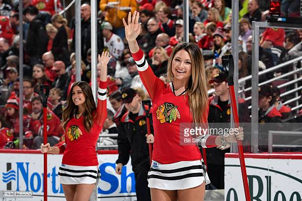 Members of the Chicago Blackhawks icecrew wave to the crowd during the game between the Chicago Blackhawks and the Vancouver Canucks at the United...