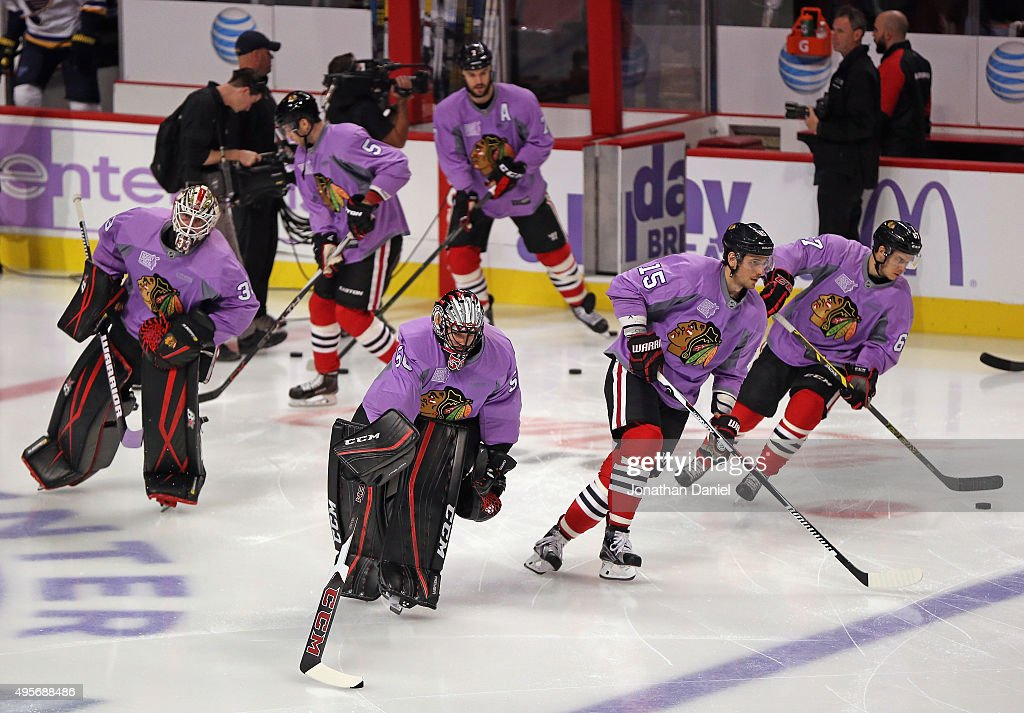 Members of the Chicago Blackhawks skate during warm-ups wearing purple jerseys for the 'Hoickey Fights Cancer' awareness campaign before a ganme against the St. Louis Blues at the United Center on November 4, 2015 in Chicago, Illinois.