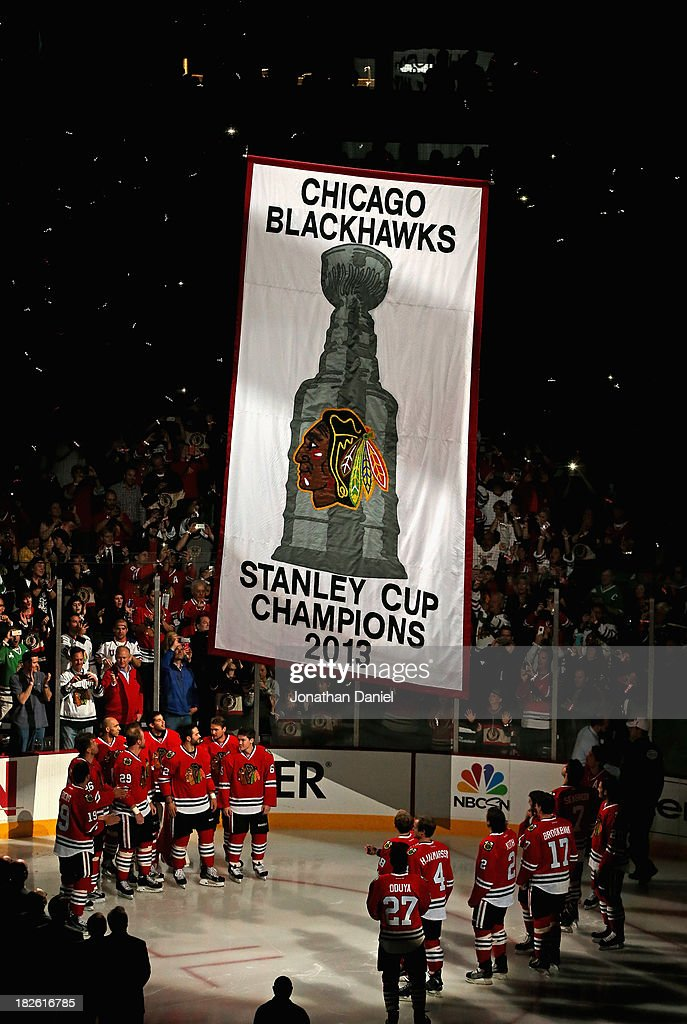 Members of the Chicago Blackhawks watch as the Championship banner is hung during a ceremony before taking on the Washington Capitals at the United Center on October 1, 2013 in Chicago, Illinois.