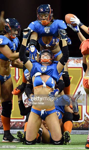 Members of the Chicago Bliss including Alli Alberts and ChrisDell Harris celebrate in the end zone after Alberts scored a touchdown against the Las...